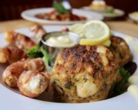 Bertha's Jumbo Lump Crab Cakes Hand Made in Baltimore, Maryland With Bertha's Bacon Wrapped Pelican Shrimp